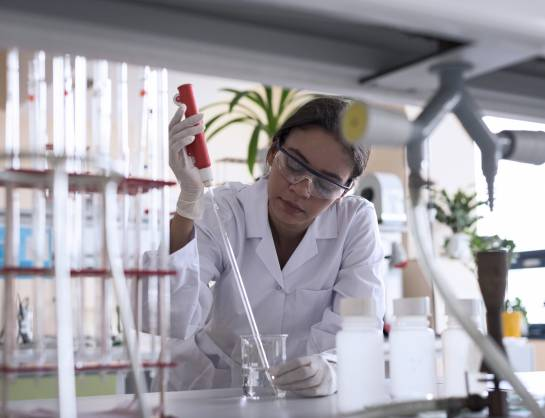 Scientist using a pipette in a lab