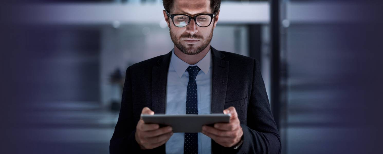 Businessman looking down at a tablet