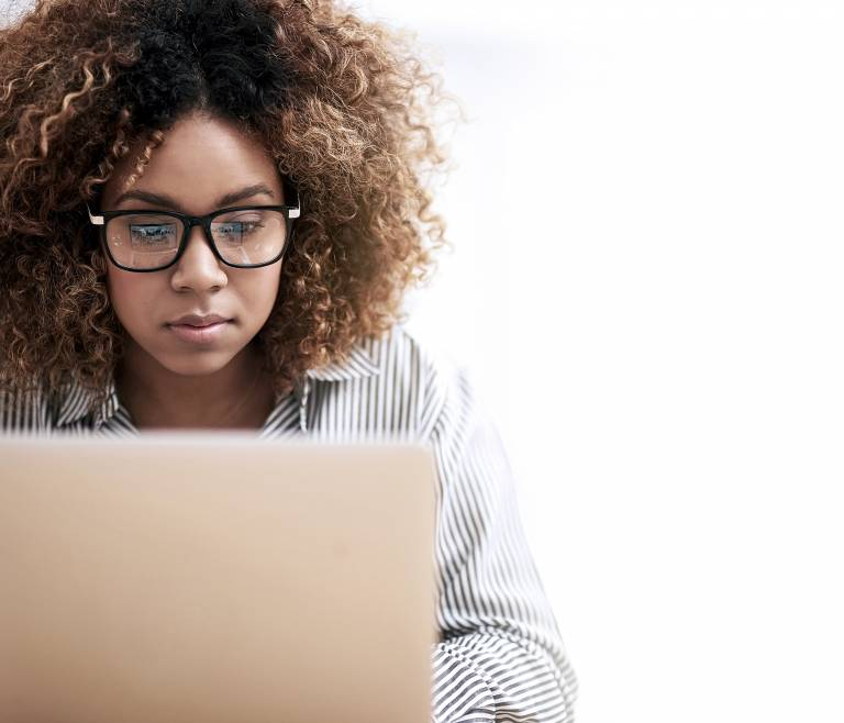 Businesswoman focused on laptop