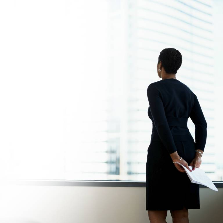Businesswoman looking out a window